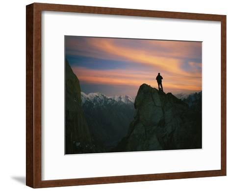 A Silhouetted Climber Watches the Sun Set over the Karakoram Mountains-Bobby Model-Framed Art Print
