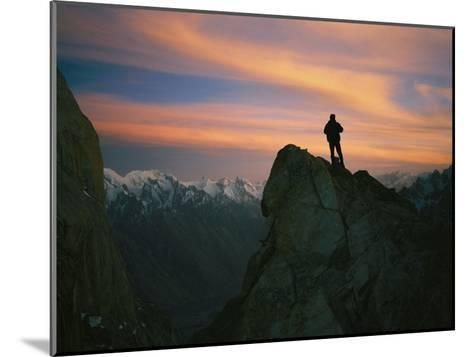 A Silhouetted Climber Watches the Sun Set over the Karakoram Mountains-Bobby Model-Mounted Photographic Print