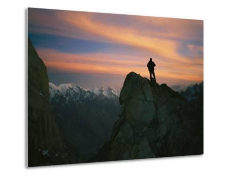 A Silhouetted Climber Watches the Sun Set over the Karakoram Mountains-Bobby Model-Metal Print
