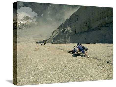 A Climber Negotiates the Second Pitch of Previously Unclimbed 3,600-Foot Granite Wall in Greenland-Bobby Model-Stretched Canvas Print
