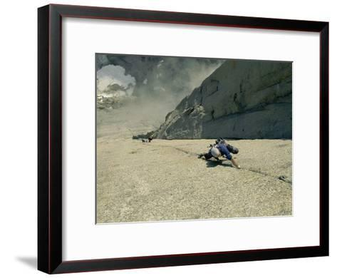 A Climber Negotiates the Second Pitch of Previously Unclimbed 3,600-Foot Granite Wall in Greenland-Bobby Model-Framed Art Print