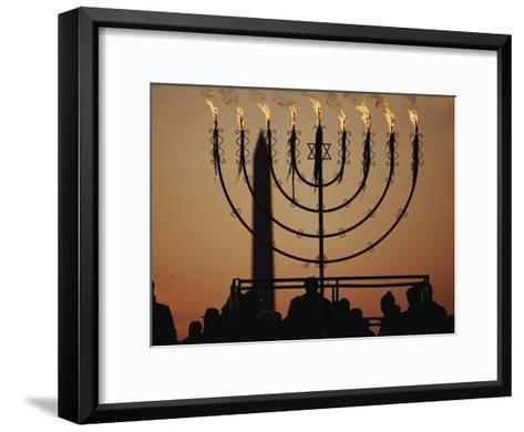 Silhouetted Worshippers Stand Before a Large Menorah Near the Washington Monument-Sam Kittner-Framed Art Print