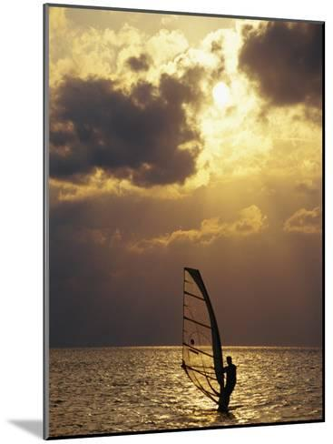A Windsurfer Skims the Water, Silhouetted by Evening Sun on Pamlico Sound-Stephen St^ John-Mounted Photographic Print