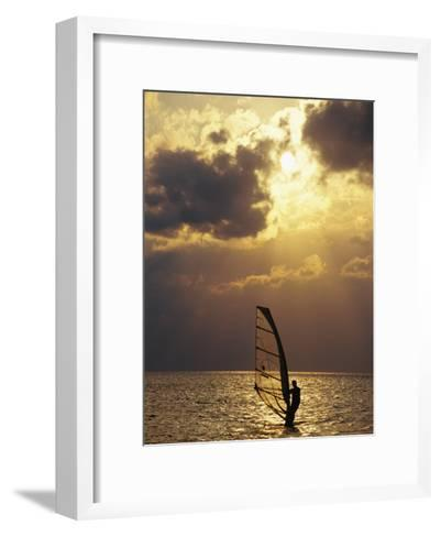 A Windsurfer Skims the Water, Silhouetted by Evening Sun on Pamlico Sound-Stephen St^ John-Framed Art Print