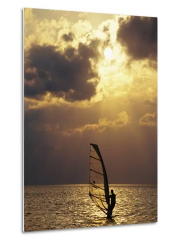 A Windsurfer Skims the Water, Silhouetted by Evening Sun on Pamlico Sound-Stephen St^ John-Metal Print