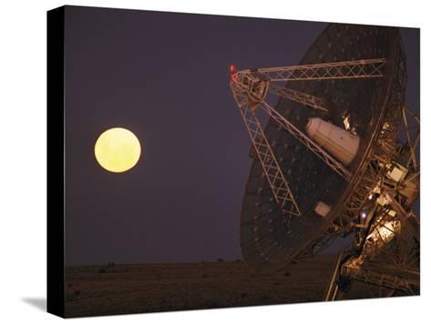 The Full Moon Rises Near a Satellite Dish-Joe Scherschel-Stretched Canvas Print