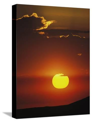 Sun and Clouds at Sunrise, Yellowstone National Park, Wyoming-Raymond Gehman-Stretched Canvas Print