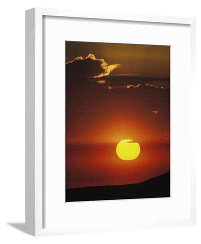 Sun and Clouds at Sunrise, Yellowstone National Park, Wyoming-Raymond Gehman-Framed Art Print