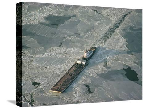 Tugboat Pushing Barge Through Winter Ice on the Chesapeake Bay-Skip Brown-Stretched Canvas Print