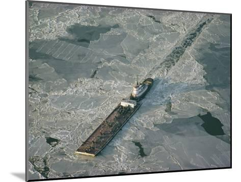 Tugboat Pushing Barge Through Winter Ice on the Chesapeake Bay-Skip Brown-Mounted Photographic Print