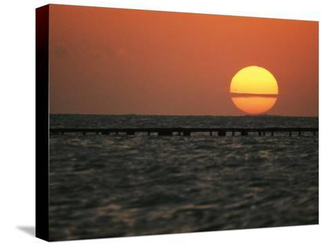 Sunset on the Water at Key West-Bill Curtsinger-Stretched Canvas Print