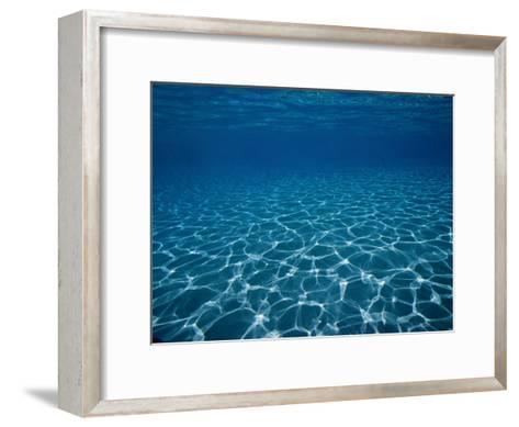 Sunlight Reflects on the Sea Floor Through Crystal Clear Blue Water-Raul Touzon-Framed Art Print