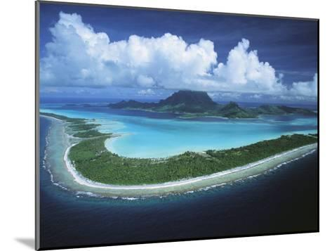 Puffy Clouds Fill the Sky over a Cluster of Polynesian Islands-Tim Laman-Mounted Photographic Print