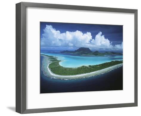 Puffy Clouds Fill the Sky over a Cluster of Polynesian Islands-Tim Laman-Framed Art Print