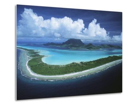 Puffy Clouds Fill the Sky over a Cluster of Polynesian Islands-Tim Laman-Metal Print