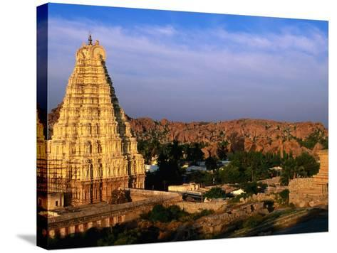 Overhead of Virupaksha Temple, Hampi Bazaar and Surrounding Hills from Hemakuta Hill, Hampi, India-Peter Ptschelinzew-Stretched Canvas Print