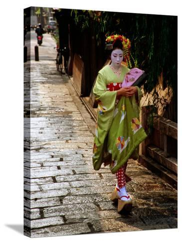 Maiko Walking Along Street in Gion, Kyoto, Japan-Frank Carter-Stretched Canvas Print