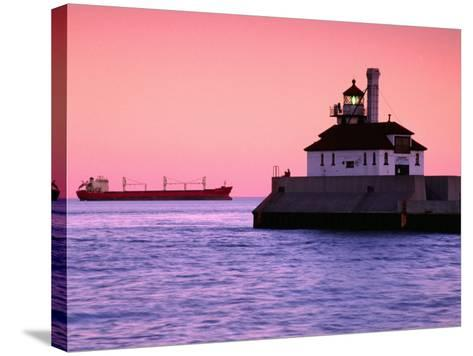 South Breakwater Outer Lighthouse at Dawn, with Ship on Horizon, Duluth Harbor, Duluth, USA-Richard Cummins-Stretched Canvas Print