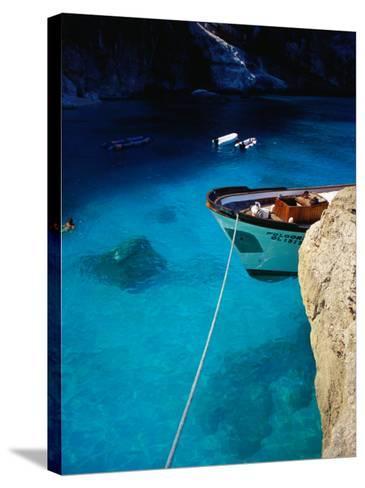 Boat in Water of Cala De Mariolu, Golfo Di Orosei, Italy-Damien Simonis-Stretched Canvas Print