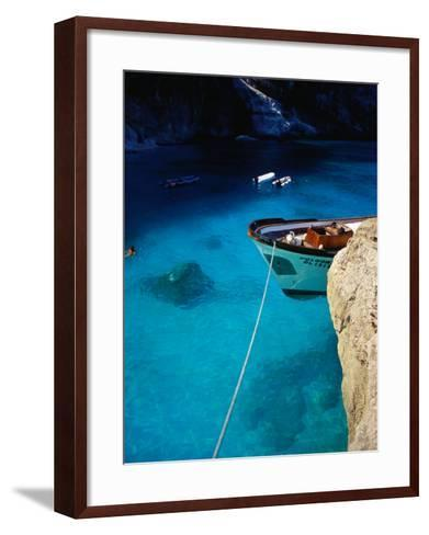 Boat in Water of Cala De Mariolu, Golfo Di Orosei, Italy-Damien Simonis-Framed Art Print