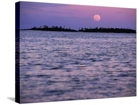 Full Moon at Sunset, Cook Islands-Peter Hendrie-Stretched Canvas Print