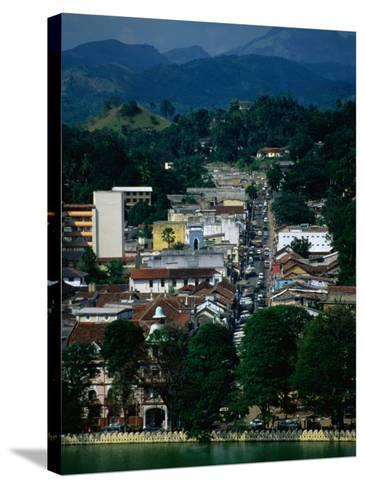 River and City Street in Distance, Kandy, Sri Lanka-Dallas Stribley-Stretched Canvas Print