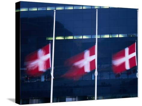 Danish Flags Flying Outside the Black Diamond Building, Copenhagen, Denmark-Martin Moos-Stretched Canvas Print