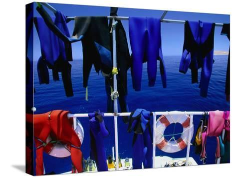 "Wetsuits Drying on ""Live-Aboard"" Dive Boat in Straits of Gubal, Egypt-Jean-Bernard Carillet-Stretched Canvas Print"