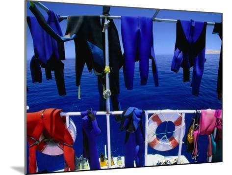 "Wetsuits Drying on ""Live-Aboard"" Dive Boat in Straits of Gubal, Egypt-Jean-Bernard Carillet-Mounted Photographic Print"