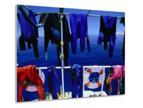"Wetsuits Drying on ""Live-Aboard"" Dive Boat in Straits of Gubal, Egypt-Jean-Bernard Carillet-Metal Print"