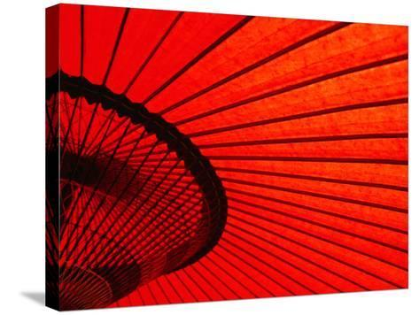 Looking Through Red Bangasa, an Oiled Rice Paper Umbrella, Japan,-Oliver Strewe-Stretched Canvas Print