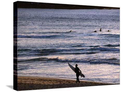 Surfers at Sunrise on Bondi Beach, Sydney, Australia-Glenn Beanland-Stretched Canvas Print