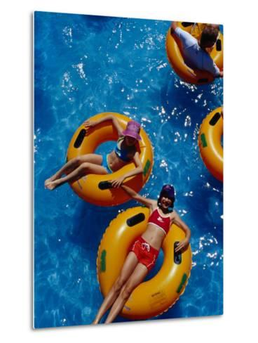 Young Girls Floating in Rubber Rings in Swimming Pool, Gold Coast, Australia-Richard I'Anson-Metal Print
