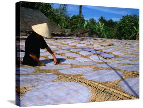 Drying Rice Paper Before Cutting into Noodles, Vietnam-Patrick Syder-Stretched Canvas Print