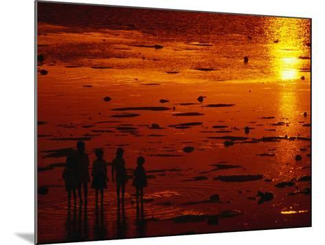 Children Silhouetted at Sunset, Ko Samui, Surat Thani, Thailand-Dallas Stribley-Mounted Photographic Print