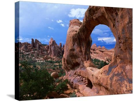 Looking Through an Arch in Arches National Monument, Utah, Arches National Park, USA-Mark Newman-Stretched Canvas Print