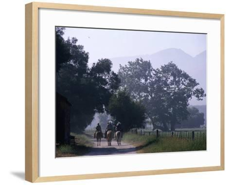 Cattlemen Riding Horses along a Road at Rancho Sisquoc, Santa Barbara, California, USA-Brent Winebrenner-Framed Art Print