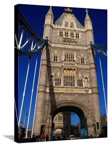 Traffic and People on the Tower Bridge - London, England-Doug McKinlay-Stretched Canvas Print