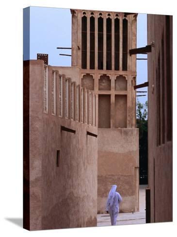 Man Walking in Lanes of Bastikia Quarter, Dubai, United Arab Emirates-Phil Weymouth-Stretched Canvas Print