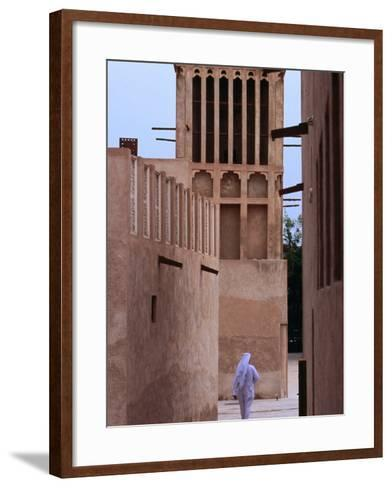 Man Walking in Lanes of Bastikia Quarter, Dubai, United Arab Emirates-Phil Weymouth-Framed Art Print