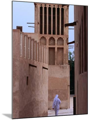 Man Walking in Lanes of Bastikia Quarter, Dubai, United Arab Emirates-Phil Weymouth-Mounted Photographic Print