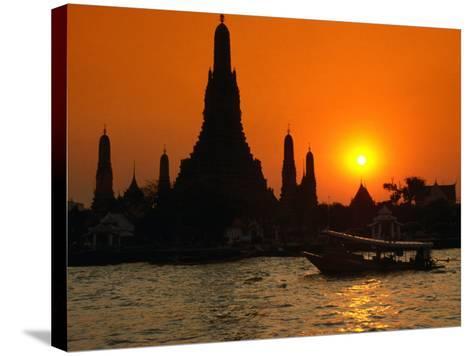 Sunset Over Temple of Dawn (Wat Arun) on River Mae Nam Chao Phraya, Bangkok, Thailand-John Elk III-Stretched Canvas Print