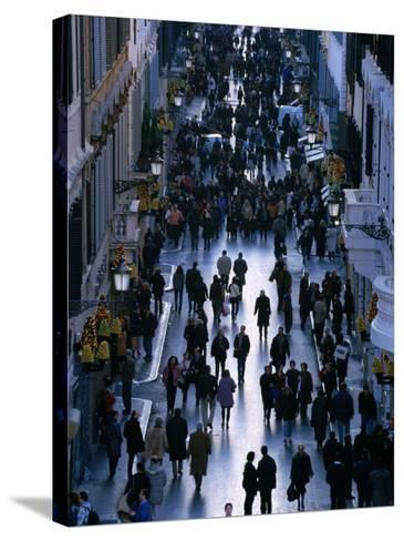 People Walk the Via Condotti as Seen from the Spanish Steps, Rome, Italy-Martin Moos-Stretched Canvas Print