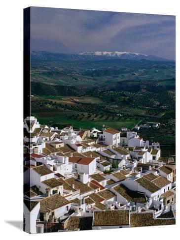 Village Rooftops and Distant Snow-Capped Mountains, Olvera, Andalucia, Spain-David Tomlinson-Stretched Canvas Print
