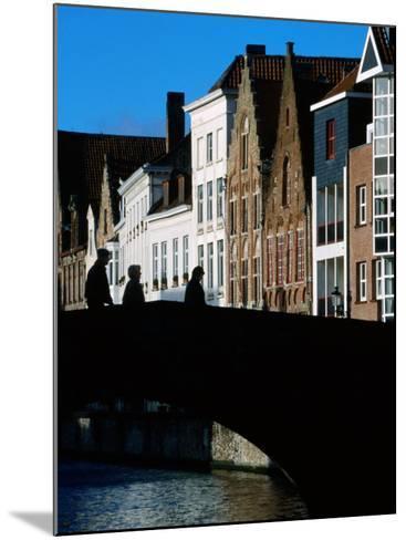 Pedestrians Crossing Canal and Houses Near Jan Van Eyckplein, Bruges, Belgium-Martin Moos-Mounted Photographic Print