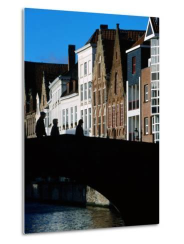 Pedestrians Crossing Canal and Houses Near Jan Van Eyckplein, Bruges, Belgium-Martin Moos-Metal Print