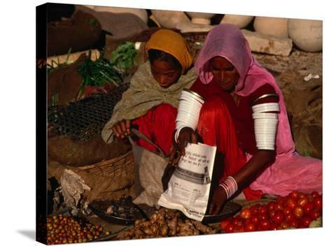 Women Selling Vegetables and Nuts at Jaisalmer Street Market, Jaisalmer, Rajasthan, India-Jane Sweeney-Stretched Canvas Print