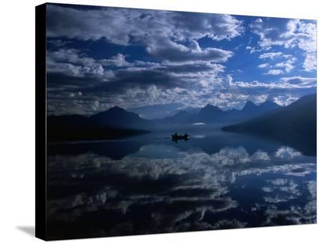 Early Morning Boating in Reflected Sea of Clouds, Lake Mcdonald, Glacier National Park, Montana-Gareth McCormack-Stretched Canvas Print