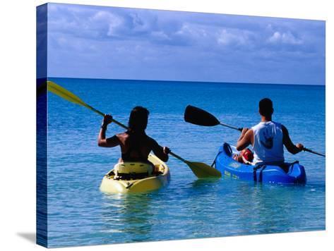 Man and Woman Kayaking on Fernandez Bay, Cat Island, Bahamas-Greg Johnston-Stretched Canvas Print