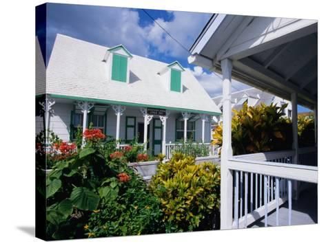 A View of Loyalist Homes and Gardens in Dunmore Town, Dunmore Town, Harbour Island, Bahamas-Greg Johnston-Stretched Canvas Print